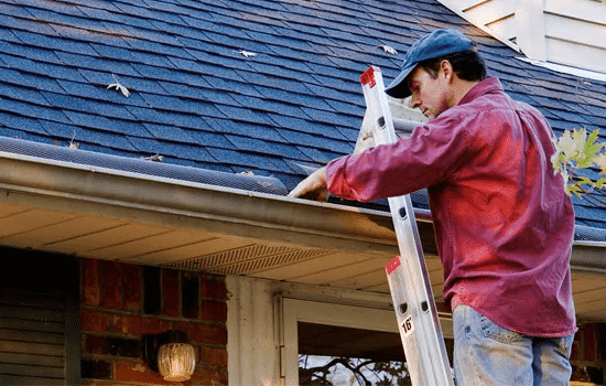 roofer cleaning gutters in seneca sc